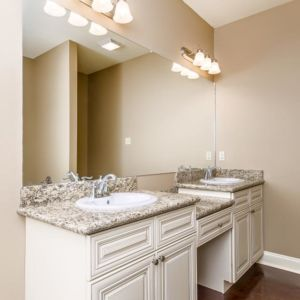 Dual vanities in the master bathroom of the Oak model