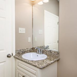 Vanity in the guest bathroom of the Oak model