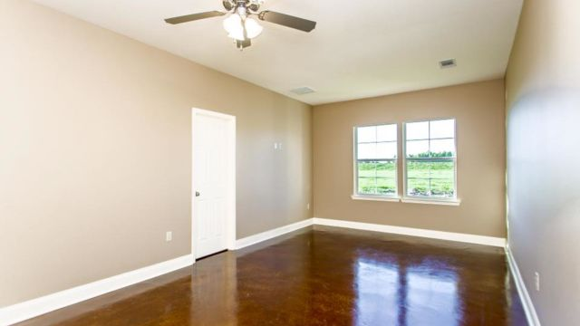 Open floor plan and stained flooring of the Oak model home