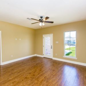 Living area and wood floors of the Willow Model