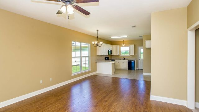 Wood floors in living area of the Willow Model