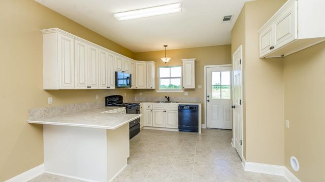 Full kitchen view of the Willow Model in Magnolia Springs